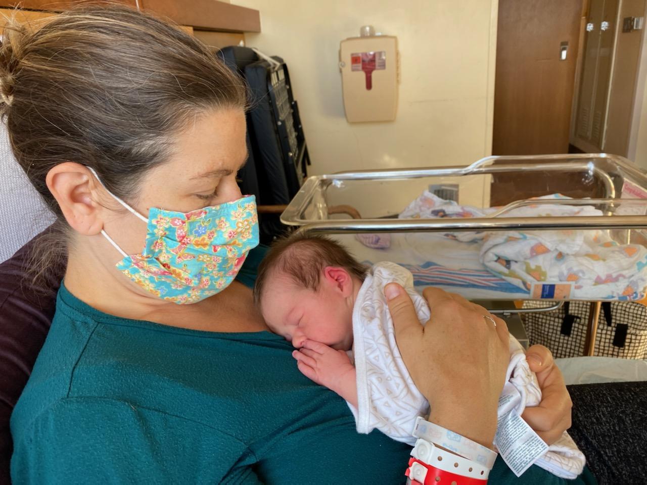 lady-holding-baby-mask-01